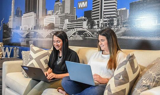 Whiteboard Marketing team working together